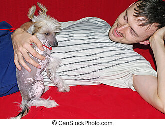 Chinese crested dog with owner
