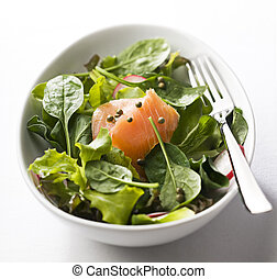 Salmon salad - Fresh green salad with smoked salmon close up