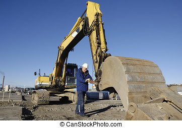 bulldozer and driver - mechanic working with giant...