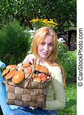 Basket, full mushrooms, and young woman-mushroom picker