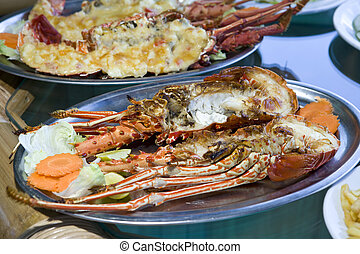 plates with lobster on table