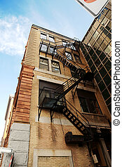 Urban dark back alley stairs - Back alley: Angle shot of the...