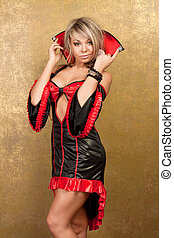 sexy blonde woman in red latex dress on golden background