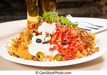 fresh nachos and vegetable salad with meat ,chili con carne...
