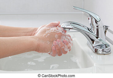 Hands Washing - Washing hands with anti bacterial soap by...