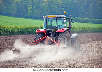 Rural tractor - Turning the fields before seeding of a new...