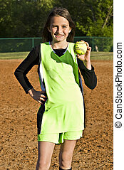 Girl Softball Player - A young girl proudly showing the game...