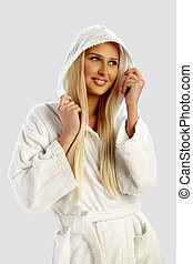 Blond girl in a white bathrobe
