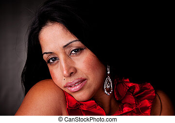 mature latin woman,sad, isolated on  black studio shot