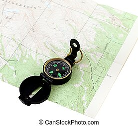 Are we lost? - A black navigational compass on a wilderness...