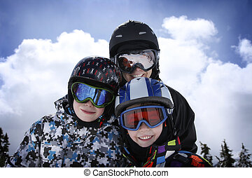 mother with two boys skiing - mother with two young boys...