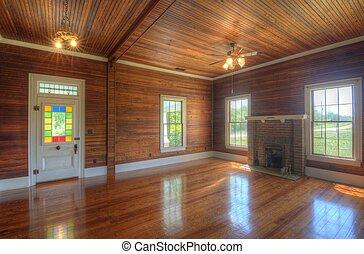 Unfurnished Living Room - A wood paneled house den,...
