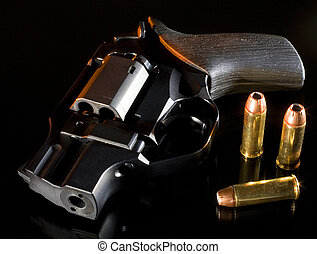 Nighttime safety - Pistol with ammuntion on a black...