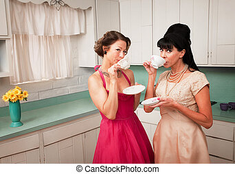 Women Drinking Coffee - Two retro-styled women drinking...