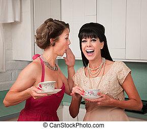 Woman Whispers Joke - Caucasian woman whispers joke to...
