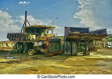 Mining trucks - Abandoned mining huge industrial trucks,...