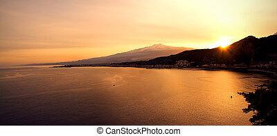 Panoraimc view of Mount Etna and sea from Taormina at sunset