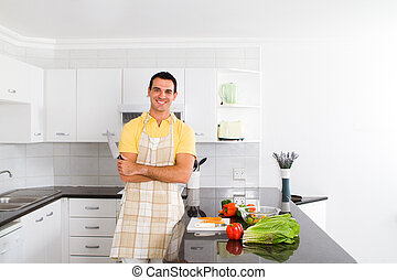 middle aged man in kitchen - happy middle aged man in a...