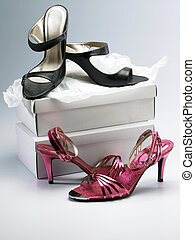 two pair of high heel shoes