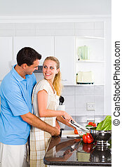 lovely young couple in kitchen