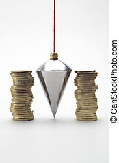 Investment - Plumb bob with coin stacks on white background