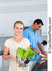 woman holding green vegetables