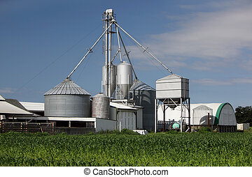 Processing Facility with multiple grain Silos on a Farm