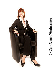 Young business woman sitting in black armchairs