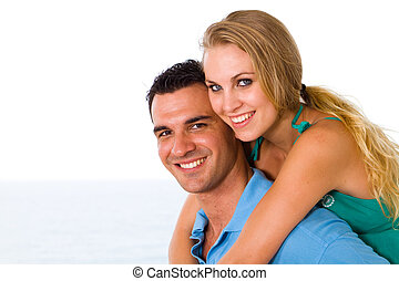 young couple piggyback - happy young couple piggyback with...