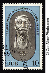 Postage stamp from GDR with Pierre de Coubertin