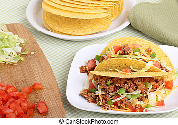 Two Tacos - Two tacos with lettuce, tomatoes, cheese on a...