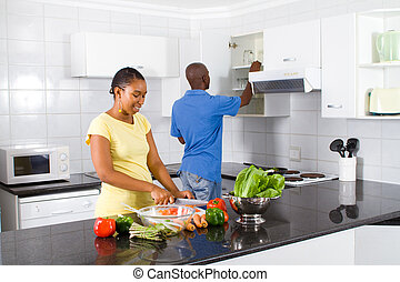 couple preparing food - happy african american couple...