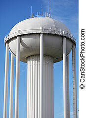 Water Tower - Water tower painted in white against blue sky