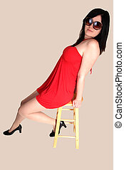 Girl in red dress. - A lovely young woman sitting on a...