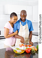 couple in kitchen cooking - young african american couple in...