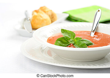 Tomato Basil Soup - Bowl of homemade hot basil and tomato...