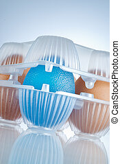 transgenic food - eggs package, the blue egg stands for GMO...