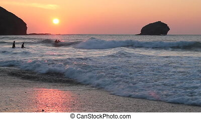 Sunset in Portreath, Cornwall UK - Atlantic waves at sunset...