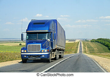 Road - A blue trailer truck along the road