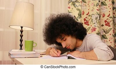 young man getting sleepy while studying 2