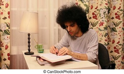 young man studying on the book