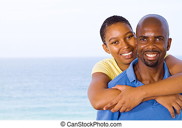 african american couple piggyback - young happy african...