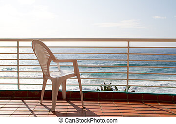 balcony with empty chair - sea view balcony with empty chair
