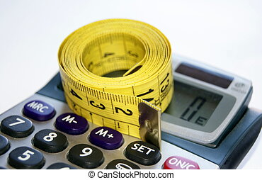 Calculator with tape measure isolated in white