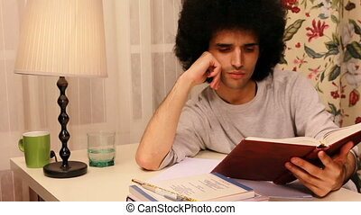 young man studying on the book 2