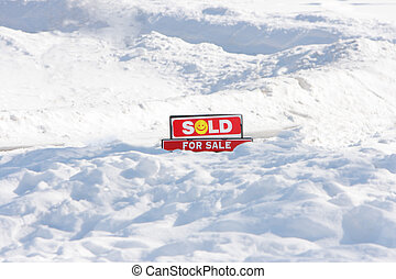 Sold Sign - For Sale sign, sold, on snow ground