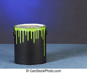 can of paint with drips on can on blue background