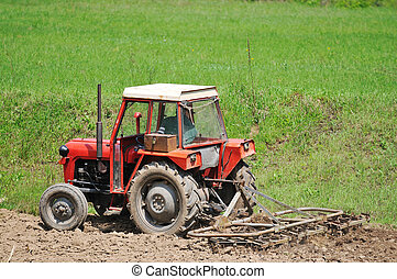 rural field farming - tractor trails with ground and grass...