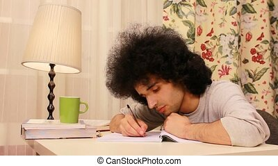 young man getting sleepy while studying 3