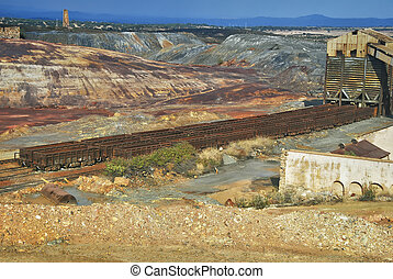 Mining gold industry - Abandoned facilities freight cars,...